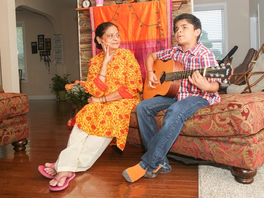 "From left, Dr. Shaila Shibad watches as her grandson, Sankalp Shibad, plays and sings ""Hey Jude"" on guitar in their home in Brentwood. Dr. Shibad retired from practicing medicine and moved from India to live with her son, Salil, his wife, Sahana, and their two children in Brentwood."