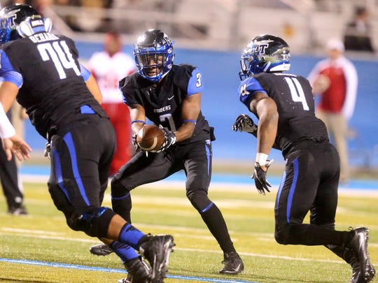 MTSU's Richie James (3) fakes a hand-off to I'Tavius Mathers before runinig the option during the game against FAU, on Saturday, Nov. 26, 2016.