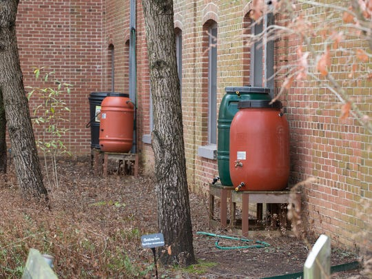 View of a rain barrels inside the courtyard of DNREC's downtown Dover campus, the Richardson & Robbins Building.