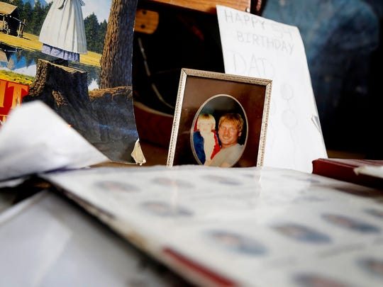 The first photo taken of Kraig Moss and his son, Rob, sits among yearbooks and trinkets in Moss' Owego home. Rob Moss died of a heroin overdose in 2014 at the age of 24.