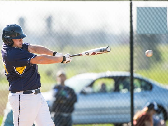 Elco's Travis Weaver connects on a pitch as Elco held