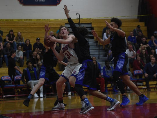 Reno takes on McQueen during their basketball game at Reno on Feb. 9, 2018.
