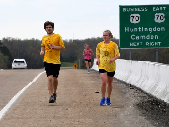 Huntingdon High School's Dawson Gremmels and Kelly Raye White run side by side during a 4-mile training run, Tuesday, April 4. Gremmels and White will be participating in the 2018 Andrew Jackson Marathon and Half Marathon.