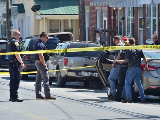 Chambersburg police in July investigate a drive-by shooting on South Franklin Street.