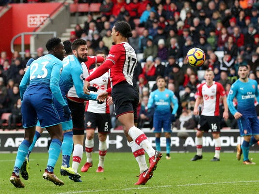 Arsenal's Olivier Giroud, center, scores his side's first goal of the game during the English Premier League soccer match against Southampton at St Mary's Stadium, Southampton, England, Sunday Dec. 10, 2017. (Adam Davy/PA via AP)