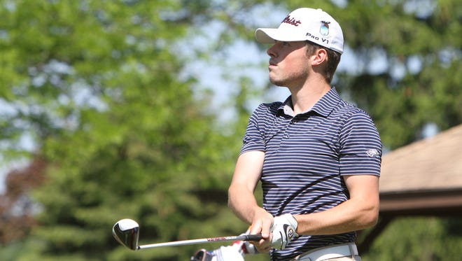 Mitchell Cotten, the top player on Hartland's golf team, learned the sport from his father, who died on April 2. Cotten has been playing golf and lacrosse this spring.