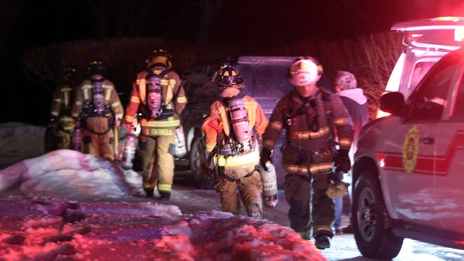 Bedford Hills firefighters battle a fire in a house at Buxton Gorge Farm on Buxton Road in Bedford Hills early Tuesday morning Feb. 17, 2015. Firefighters from several northern Westchester departments assisted at the scene.