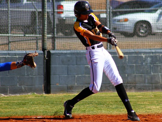 Alamogordo's Rooster Williams makes contact with a ball Saturday afternoon.