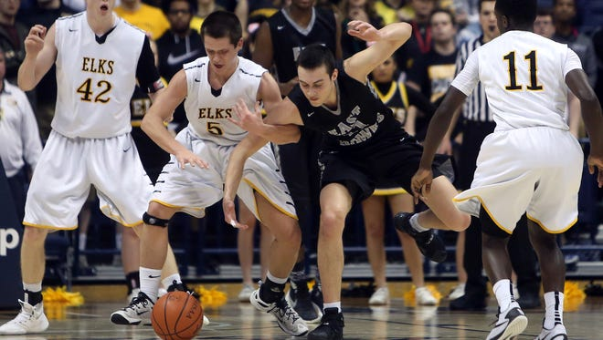 Centerville guard Kevin Meiners, left, and Lakota East forward Andrew Emrick battle for the ball.