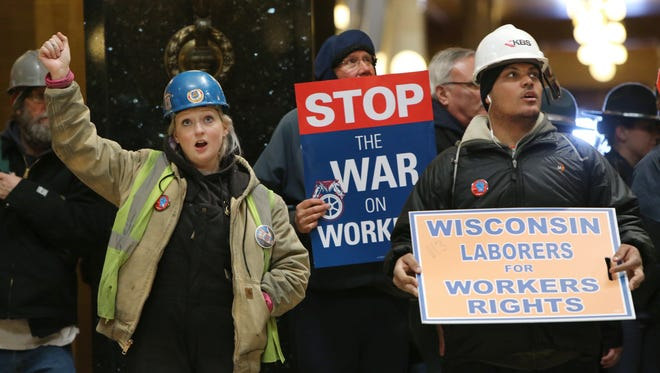 Mary Will, left, with Local 68, and Corey Smith, right, with Local 113, chant 'Union Strong' during a rally inside the state Capitol in Madison as the Assembly debated the right-to-work bill last week.