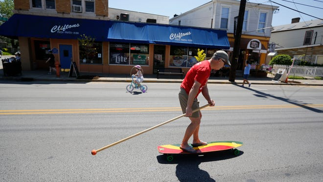 """Bob Diehl """"land paddled"""" his way along Frankfort Ave. during the CycLOUvia event. April 24, 2016."""
