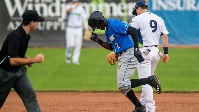 The Hudson Valley Renegades' Vidal Brujan leaves the field after being tagged out by the Lake Monsters' Ryan Gridley at Centennial Field in Burlington on Friday, July 7, 2017.