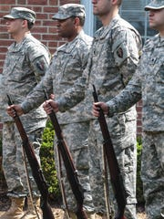 Men of the National Guard Field Artillery participate in the ceremony for the annual Memorial Day Parade in Morristown on May 25.