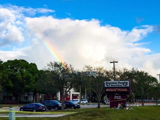 A rainbow forms over Marjory Stoneman Douglas High School on Monday morning, Feb. 26, 2018. The teachers of Stoneman Douglas High School reported back to their classrooms almost two weeks after the Feb. 14 school shooting that claimed the lives of 17 students and teachers. Only employees with school badges were let in. A small group of supporters showed up with signs and waved and cheered as the teachers arrived.
