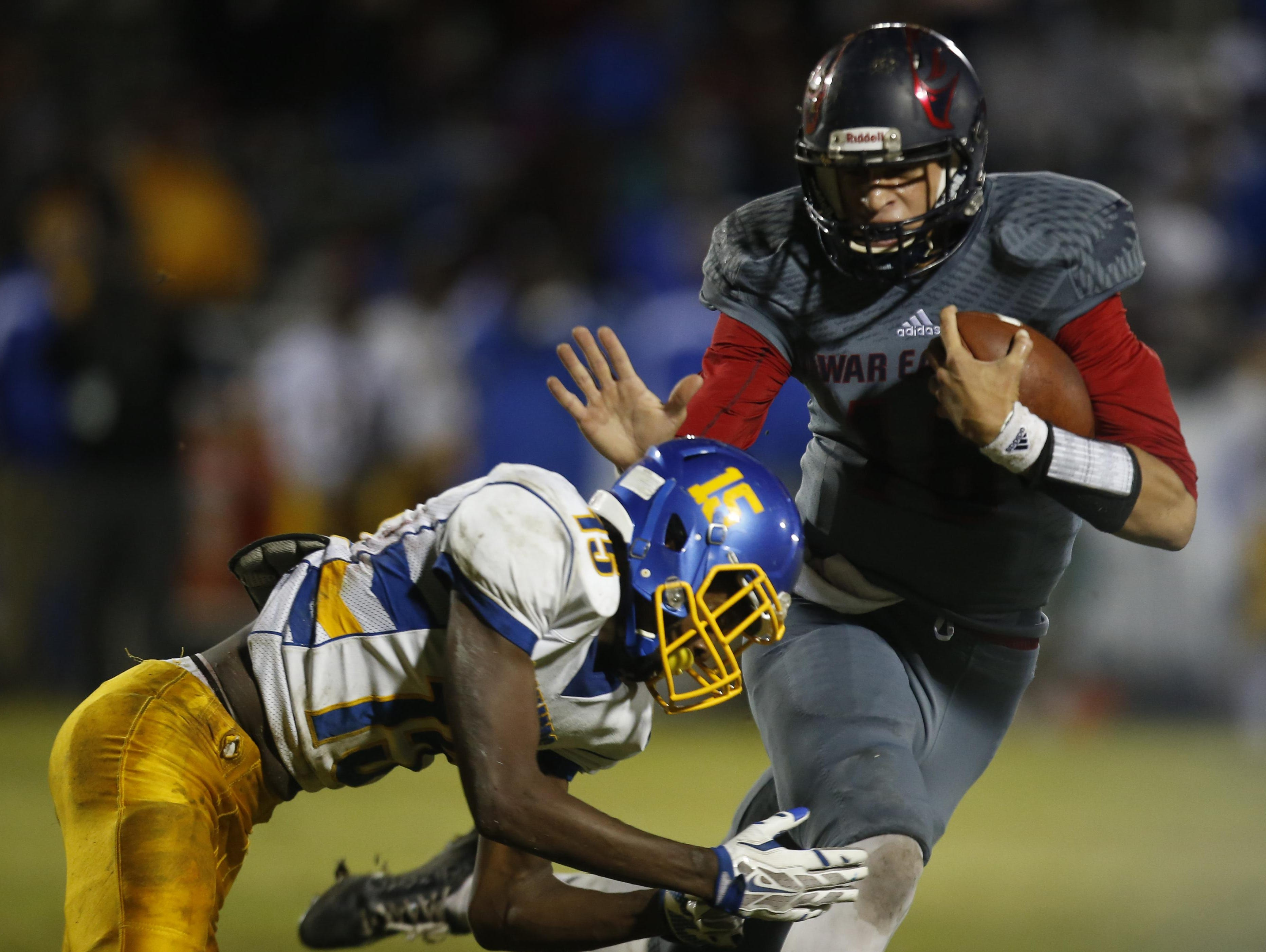 Wakulla quarterback Feleipe Franks tries to evade the tackle of Rickards' Javon Peterson during a playoff game last Friday night. Franks decommitted from LSU on Monday, opening up his recruitment by others, including Florida.