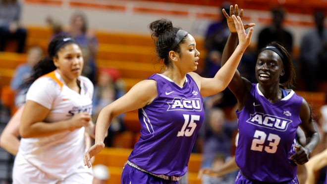 Abilene Christian's Alexis Mason (15) and Suzzy Dimba (23) celebrate in front of Oklahoma State's Kaylee Jensen (54) after a basket in the first round of the Women's NIT in Stillwater, Okla., Thursday, March 16, 2017.