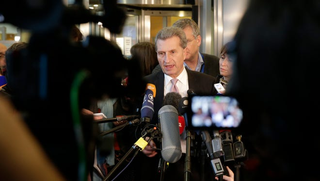 EU Commissioner for Energy Guenther Oettinger addresses the media at the European Commission headquarters in Brussels, Wednesday, Oct. 29, 2014.