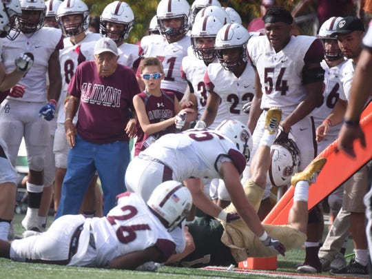 St. Joseph's Jaden Budka (1) makes a catch in front of Don Bosco's sideline on Saturday, Oct. 7, 2017. St. Joseph won the game, 16-15.