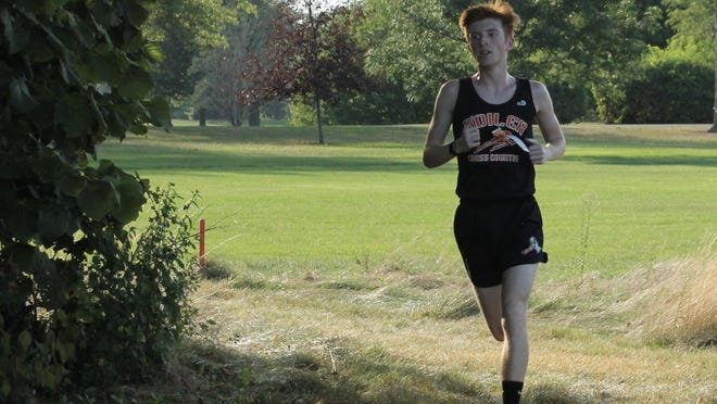 Kewanee's Colin Vanstechelman races through the rough after taking the lead on Friday in the cross country season opener at Baker Park.