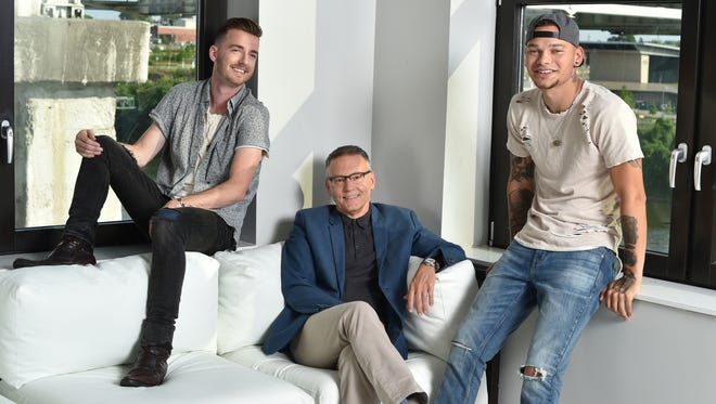 Brandon Lancaster of LANCO, left, Sony Music Nashville Chairman and CEO Randy Goodman and Kane Brown.
