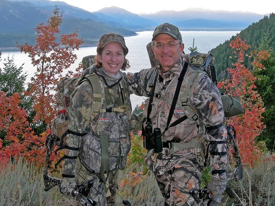Leah and Patrick Durkin stand atop an Idaho mountain
