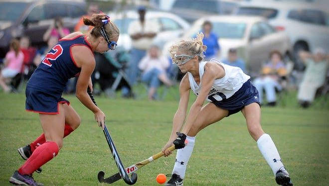 Worcester Prep's Hailee Arrington (2) matches up with Holly Grove's Brooke Bodley (10) in the ESIAC championship field hockey game in Westover on Friday, Oct. 21, 2016.