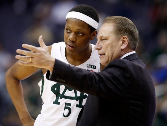 Michigan State guard Cassius Winston listens to head coach Tom Izzo during the second half of an NCAA college basketball game against Penn State in the Big Ten tournament, Thursday, March 9, 2017, in Washington. Michigan State won 78-51. (AP Photo/Alex Brandon)