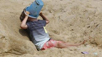 Kai Raicer takes a break after working on sandcastle during 32nd annual Sandcastle Contest in Belmar, NJ. Asbury Park,NJ. Wednesday, July 18, 2018. Noah K. Murray-Correspondent Asbury Park Press