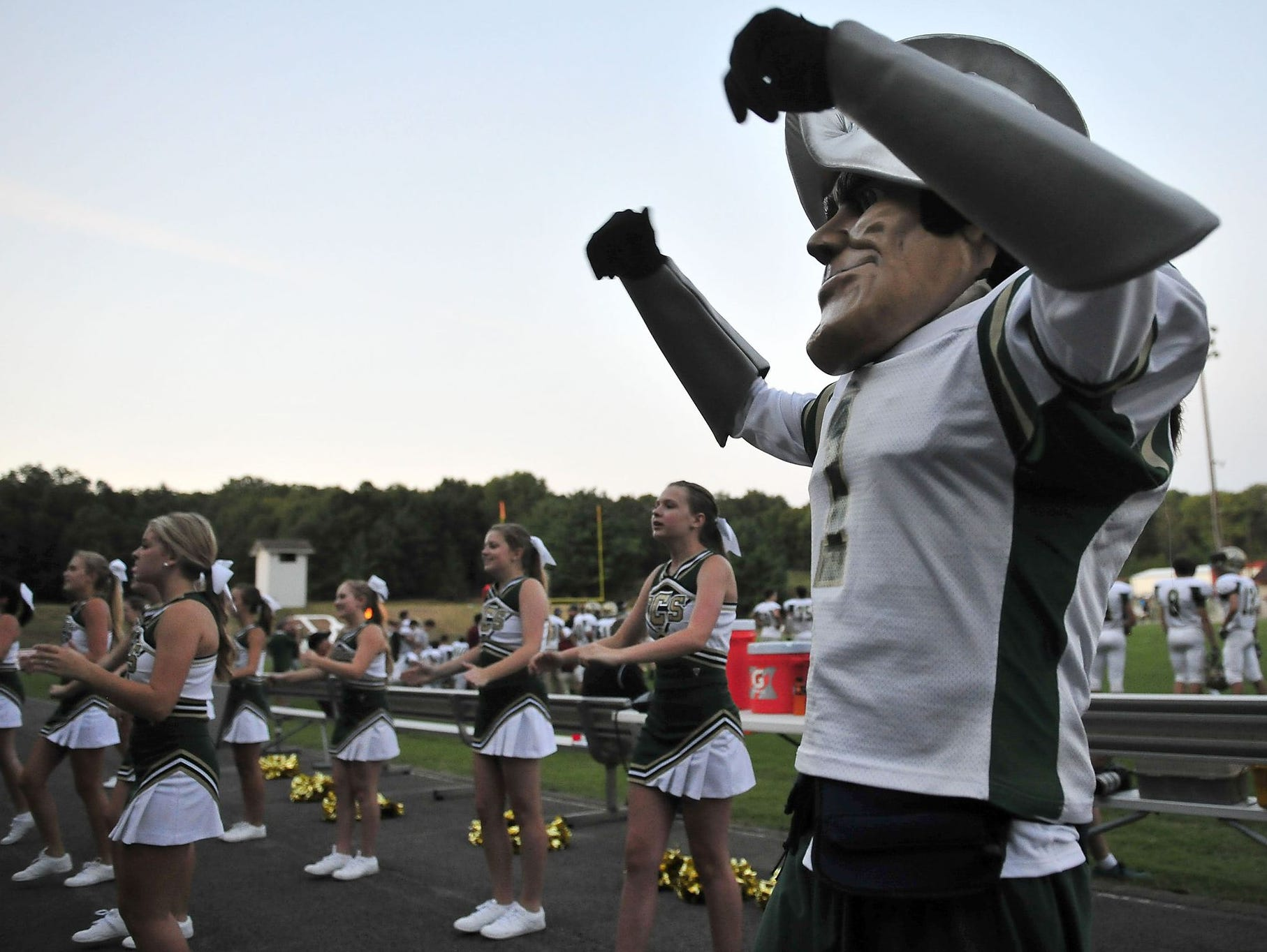 The Friendship Christian mascot and cheerleaders cheer on the Commanders.