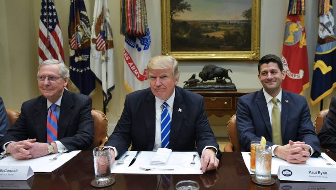 President Trump meets with congressional GOP leaders, including Senate Majority Leader Mitch McConnell, left, and House Speaker Paul Ryan, at the White House on March 1.