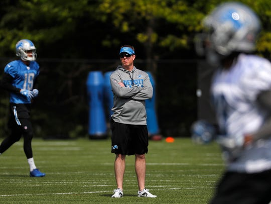 Lions general manager Bob Quinn watches practice in Allen Park on May 24, 2017.