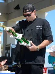 Chef Jeffrey Newbill of Peg Leg Pete's, checks out his trophy after winning the cooking competition Sept. 16, 2017, during Taste of the Beach at Pensacola Beach.