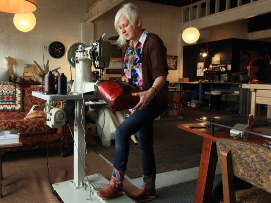 Robyn Porteen sews a bag designed to help photographers