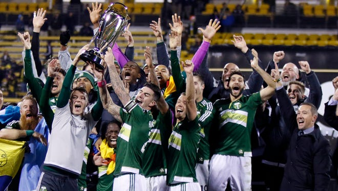 Portland Timbers raise the trophy after defeating the Columbus Crew 2-1 in the MLS Cup championship soccer game in Columbus, Ohio. After celebrating its 20th anniversary a year ago with an appreciation for the ups and downs that got MLS to age 20, the league is now moving into its next stage of continuing growth while competing with other leagues around the world.