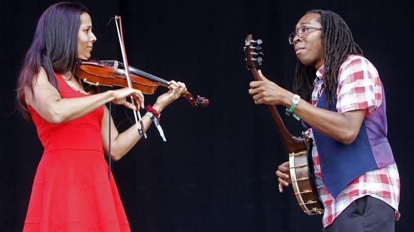 Rhiannon Giddens (left) and Hubby Jenkins of Carolina Chocolate Drops perform at the Bonnaroo Music and Arts Festival last year.