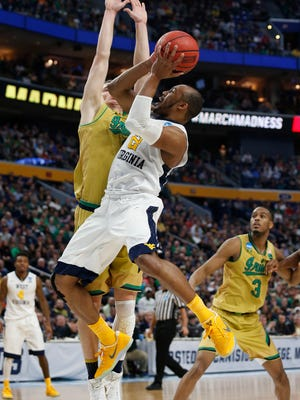 West Virginia Mountaineers guard Jevon Carter (2) shoots against Notre Dame Fighting Irish guard Rex Pflueger (0) in the second half during the second round of the 2017 NCAA Tournament at KeyBank Center.