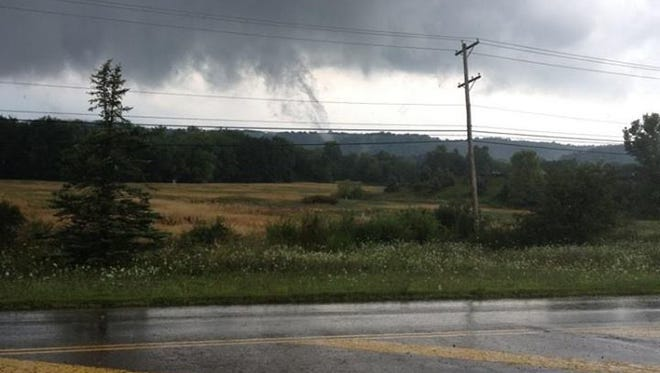 A passing motorist snapped a picture of a tornado touching down just north of Frazeysburg.