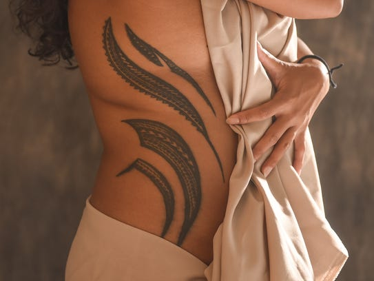 Elicia Santo Tomas displays a Samoan tribal tattoo