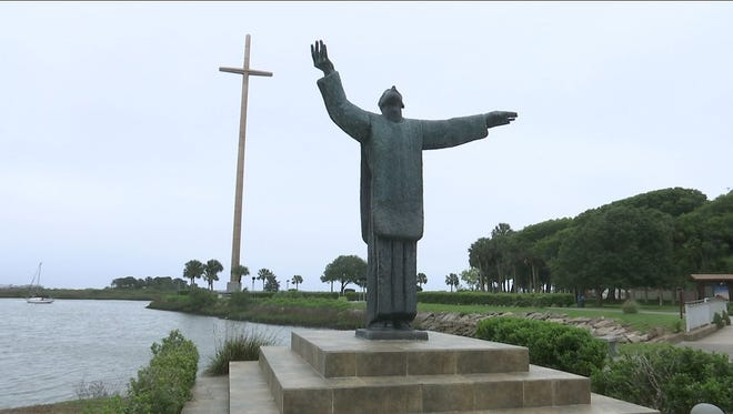 This statue of Father Francisco López and the Great Cross behind it commemorate the first Thanksgiving celebration held in St. Augustine, 55 years before the Pilgrims landed at Plymouth Rock.