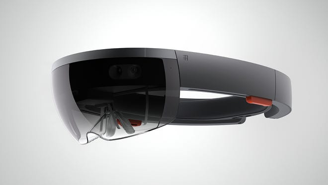 Microsoft's HoloLens, which does not require a computer, is an augmented reality projection device anchored to Windows 10. It starts shipping to developers March 30.