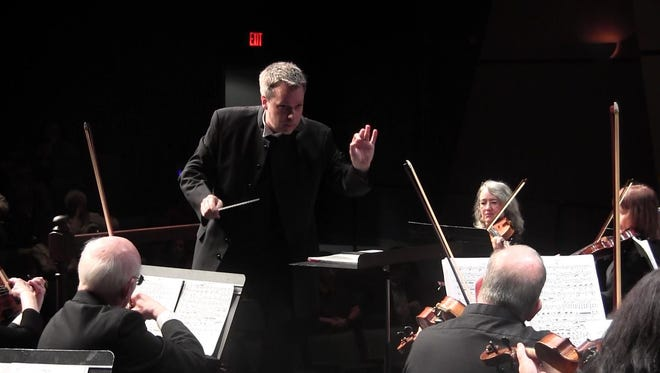 """Artistic director Sean Paul Mills conducts the Salem Philharmonia Orchestra. The orchestra's upcoming concert titled """"Music That Ignites Your Spirit"""" on April 22-23 is a low-pressure chance to try something different, Mills said."""