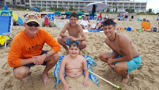 The Hains brothers, clockwise from top, Lance, Luke and Levi, enjoy a day at the beach with their father, Gordy Hains. Lance and Luke are taking part in JettRide later this month, a 600-mile bike trek to aid Levi and other young boys fighting Duchenne Muscular Dystrophy
