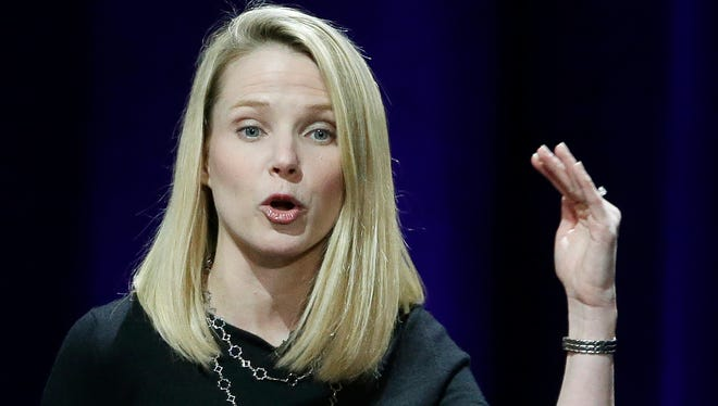 In this Feb. 19, 2015, file photo, Yahoo President and CEO Marissa Mayer delivers the keynote address at the first-ever Yahoo Mobile Developer's Conference, which took place in San Francisco.
