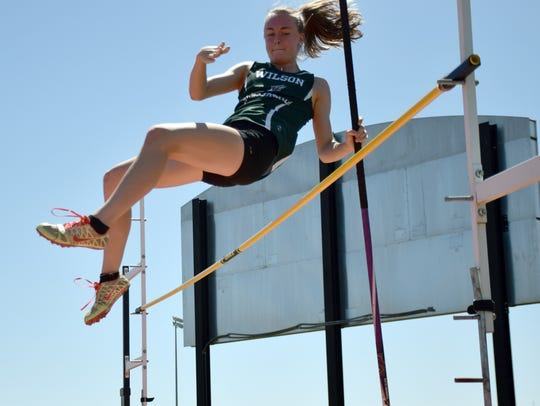 Wilson Memorial's Emilie Miller clears the bar in the