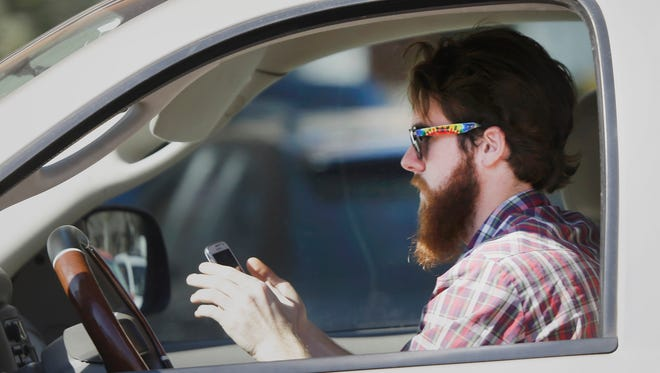 A new survey says that 18% of people admit that they cannot resist the urge to text while driving.