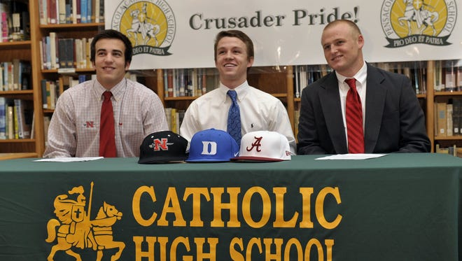 Cody Henry signing a letter of intent to play with Alabama at Catholic High school with Gavin Wehby (Nicholas State) and James McGhee (Duke).