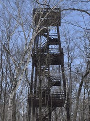 Tim Wick of Sturgeon Bay snowshoes pass the 75-foot tower inside Potawatomi State Park in Sturgeon Bay  in 2018.