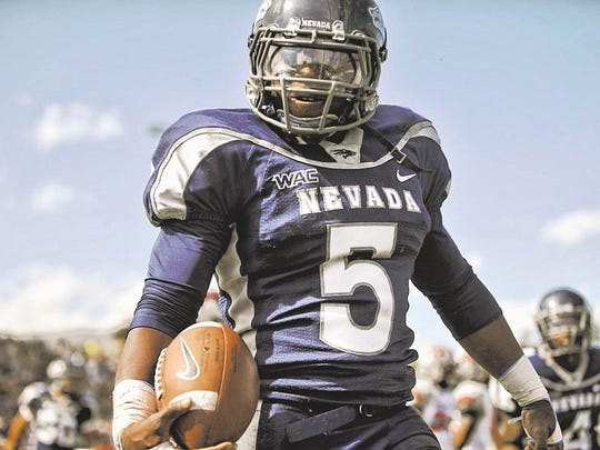 Nevada running back Mike Ball reacts after one of his five touchdowns against UNLV in 2009.
