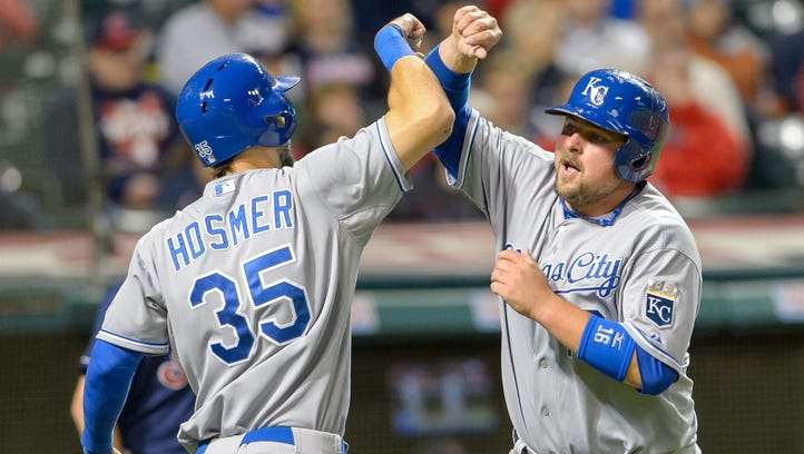 Eric Hosmer #35 celebrates with Salvador Perez #13 of the Kansas City Royals after both scored on a double by Alex Gordon in the seventh inning against the Cleveland Indians at Progressive Field on September 23, 2014 in Cleveland, Ohio.
