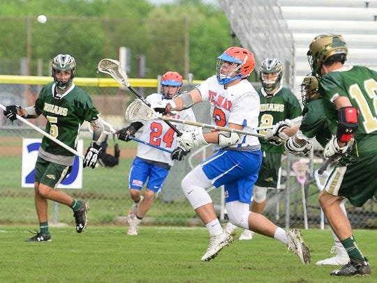 Delmas's Nick Davis with the shot on goal against Indian